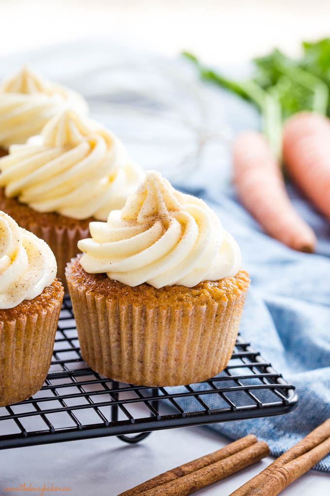 carrot cake cupcake with a swirl of cream cheese frosting and cinnamon sugar
