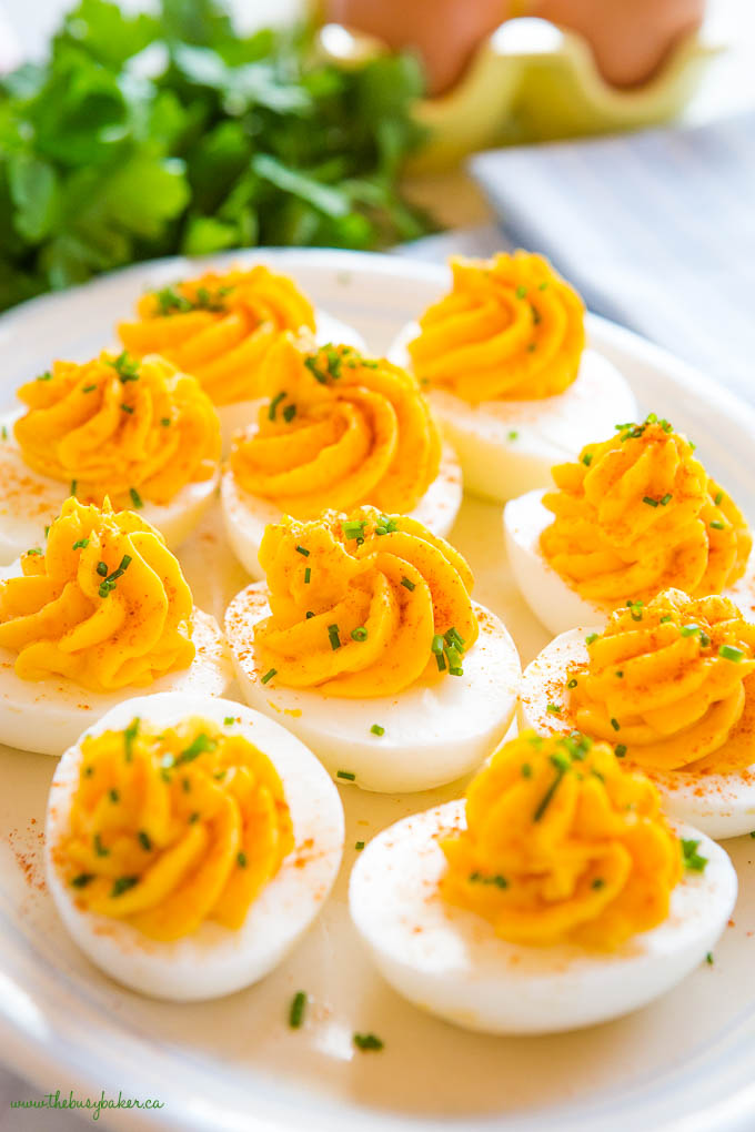 easy classic deviled eggs on platter with chives