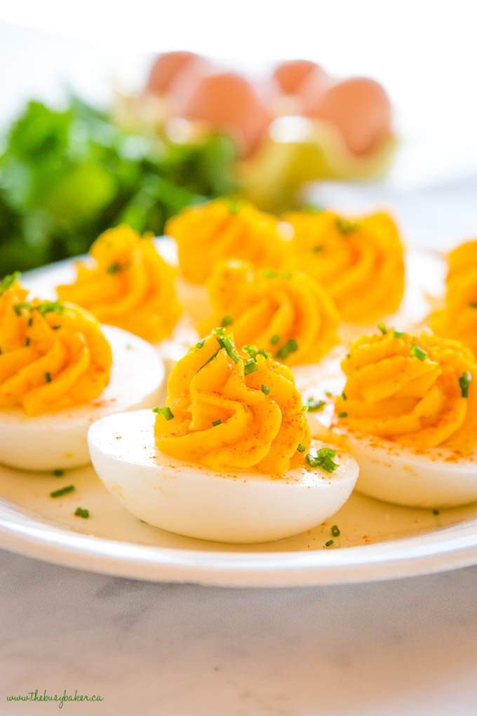 platter of easy deviled eggs garnished with chives, made with the best deviled eggs recipe