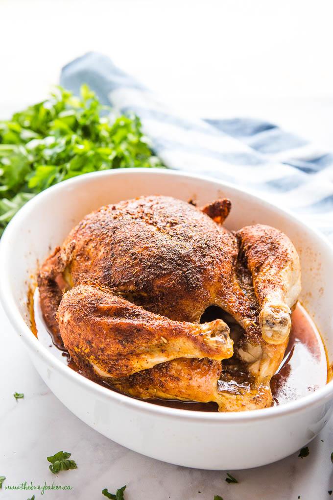 homemade rotisserie chicken in white baking dish
