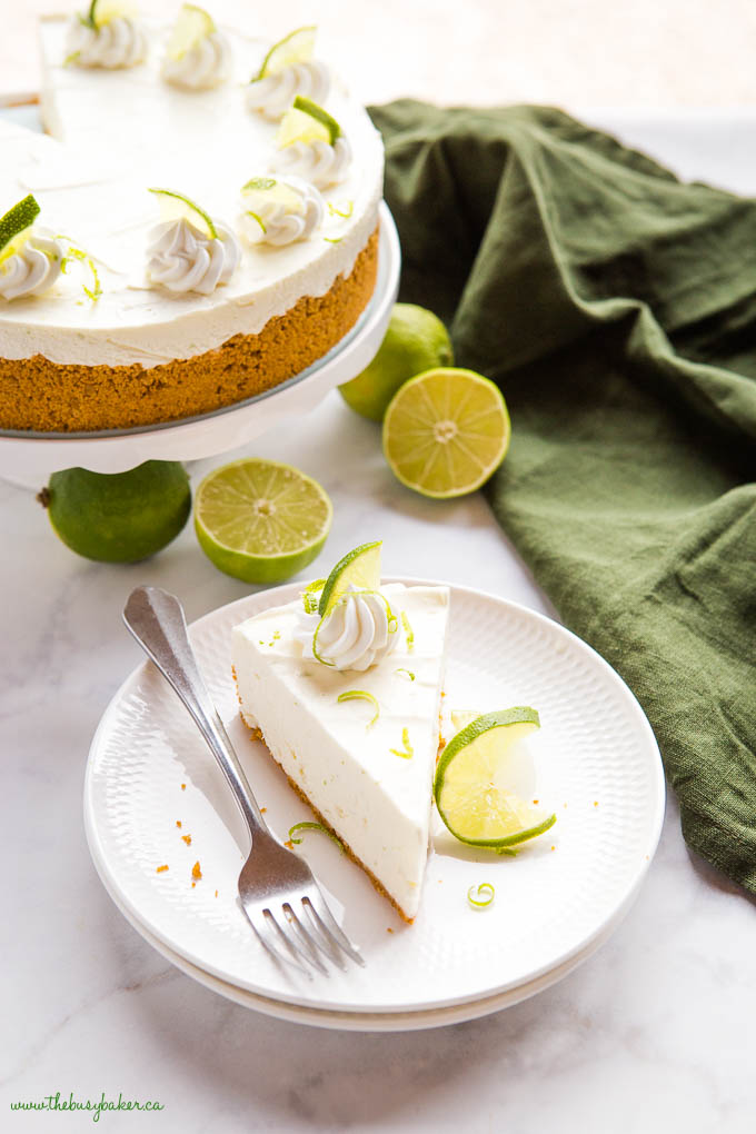 slice of key lime cheesecake on white plate with fork