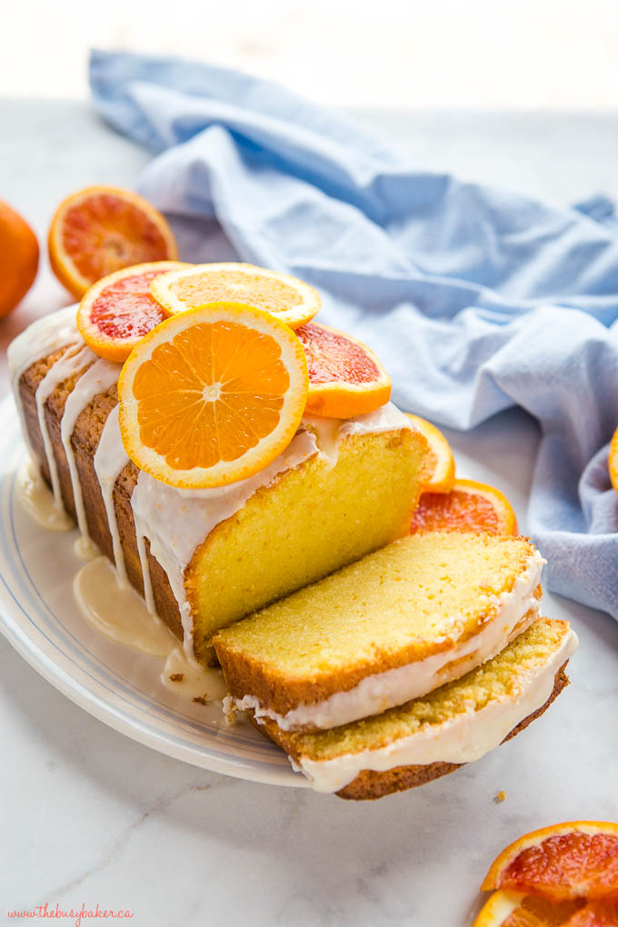loaf of glazed pound cake with slices of oranges and grapefruit on top