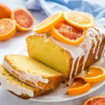 loaf of orange sour cream pound cake with citrus glaze