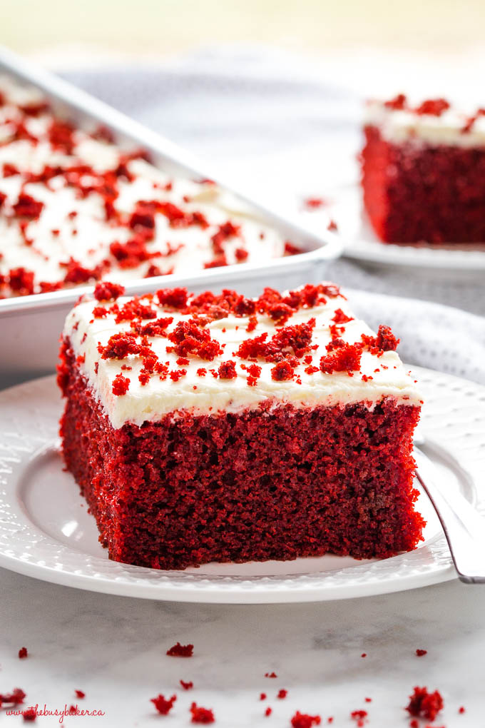 red velvet cake on white plate with cream cheese frosting