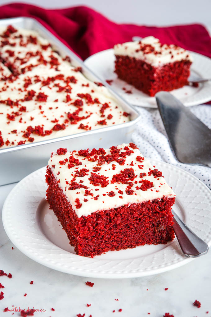 slice of red velvet cake on white plate with fork