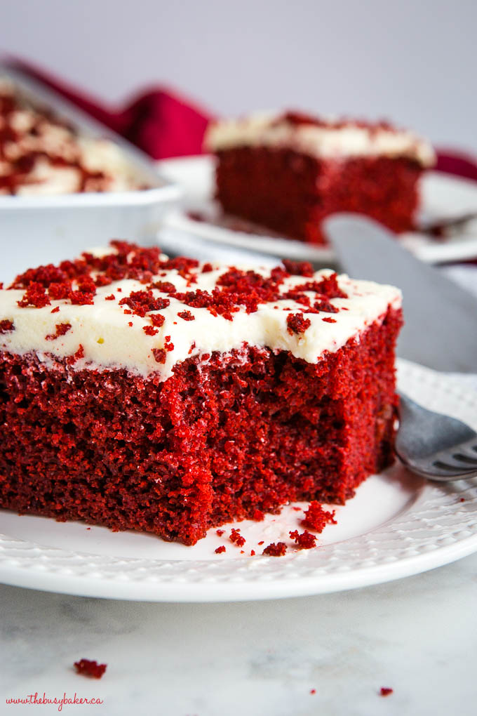 bite of red velvet cake on white plate