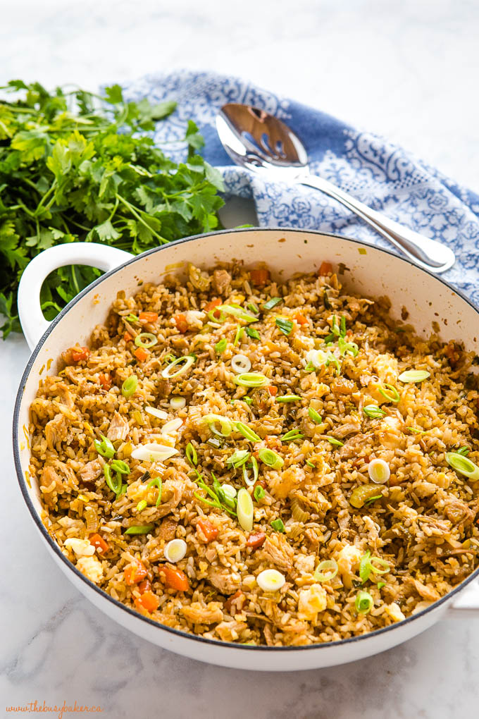 chicken fried rice in white cast iron pan
