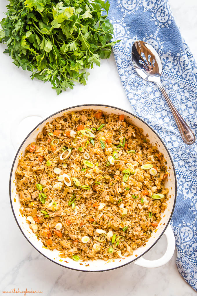 overhead image of fried rice with chicken in white pan