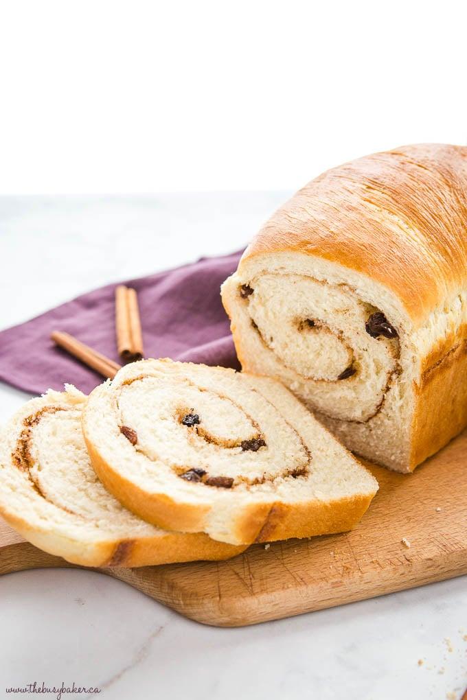 cinnamon raisin bread sliced on cutting board