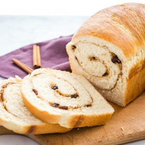 loaf of cinnamon raisin bread, cut in slices