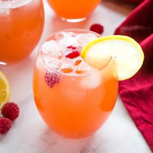 fruity punch with ice in a clear glass pitcher