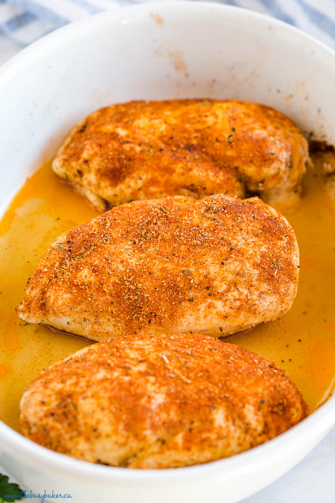 juicy baked chicken breasts in white baking dish