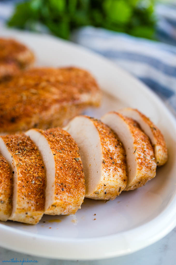 sliced baked chicken breasts with seasoning