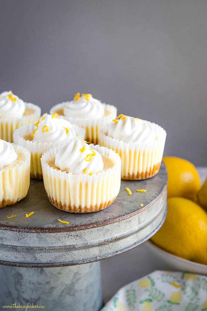 small lemon cheesecakes on cake stand