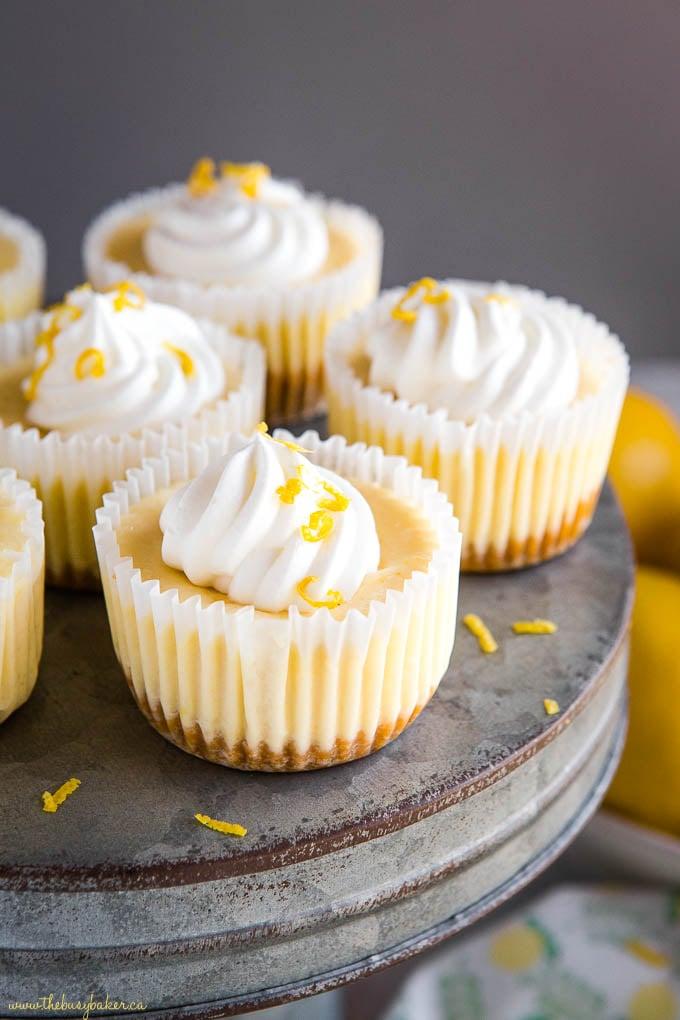 mini lemon cheesecakes on galvanized metal cake stand