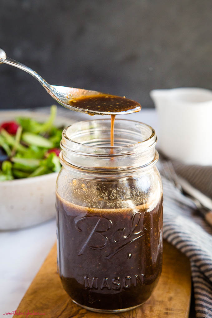 spoonful of maple balsamic salad dressing from mason jar