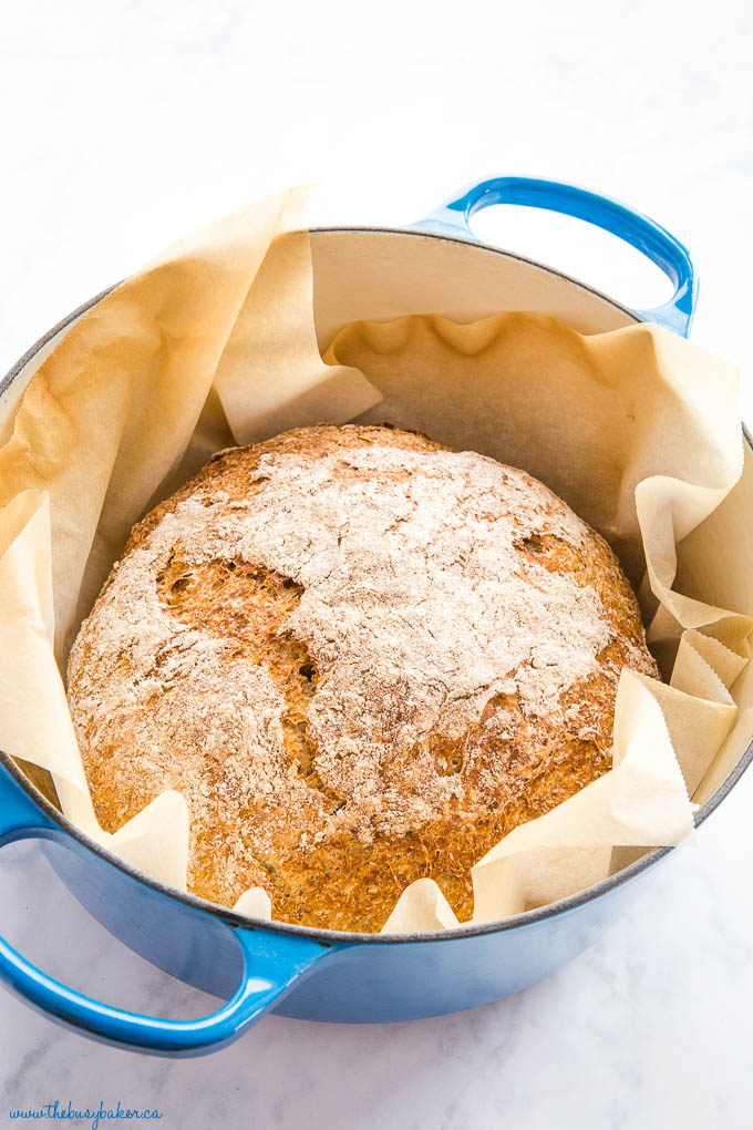 no knead whole wheat bread baked in large blue pot