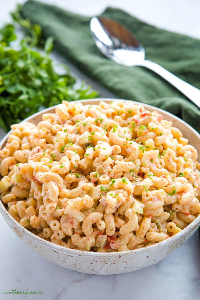 Easy Classic Macaroni Salad in speckled pottery bowl with fresh herbs