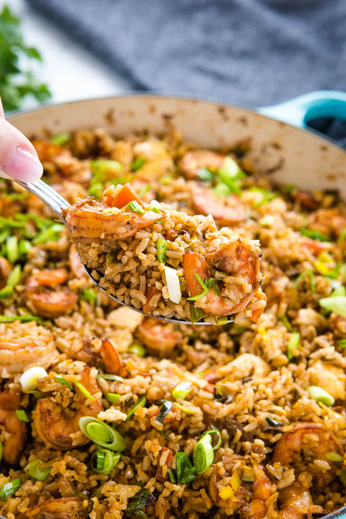 spoonful of shrimp fried rice over cast iron pan