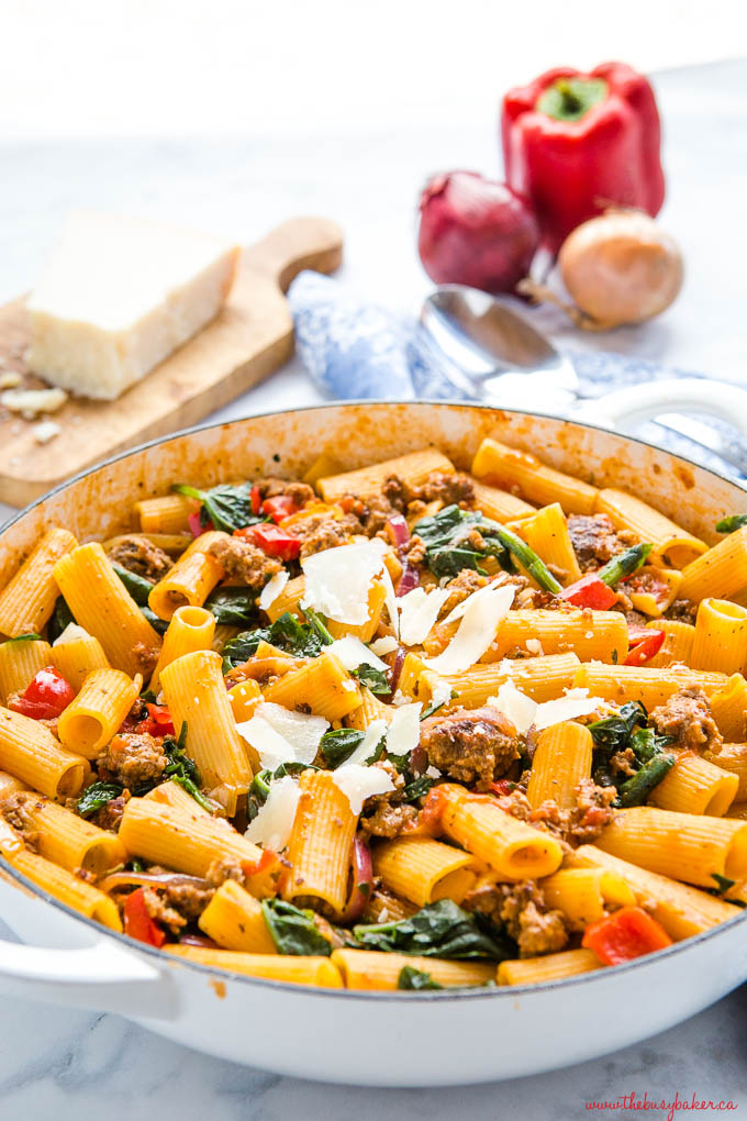 rigatoni pasta with Italian sausage, spinach, red onions, peppers and parmesan