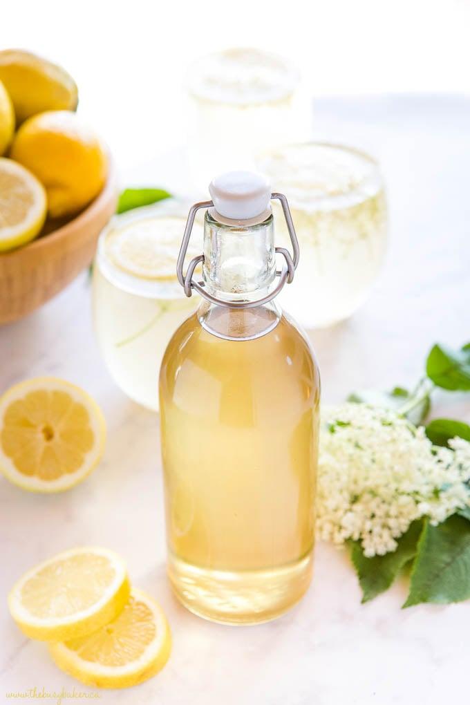 tall glass bottle of homemade elderflower syrup