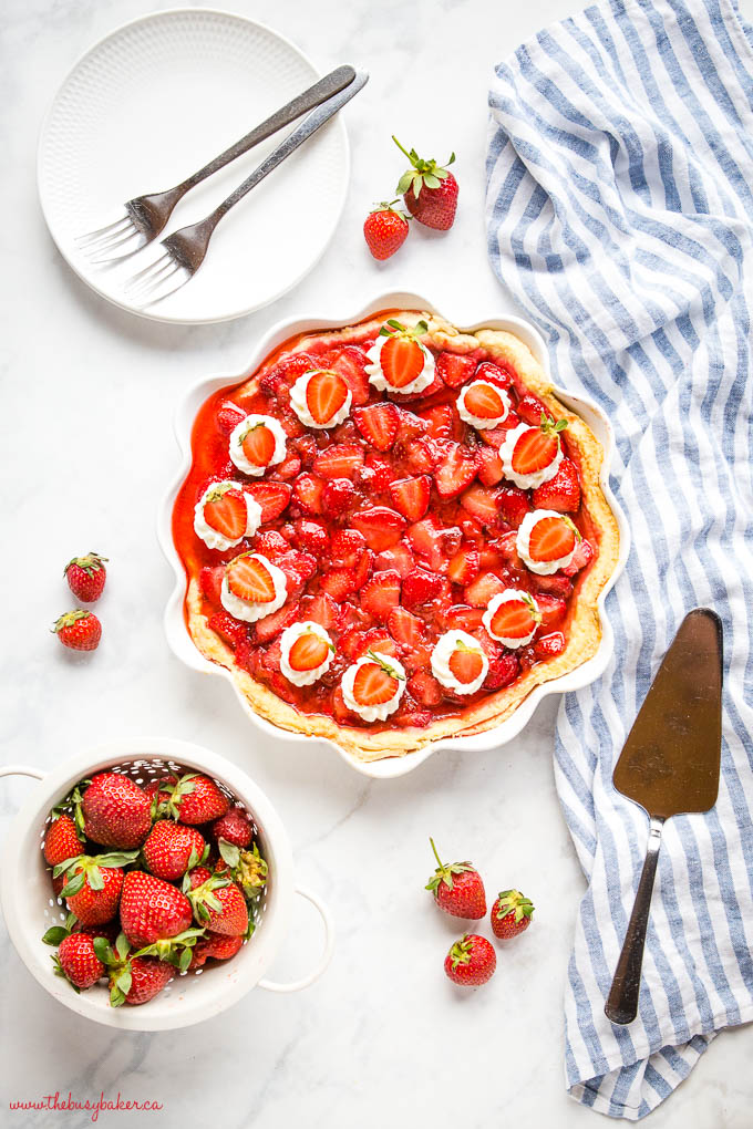overhead image: strawberry pie with whipped cream and berries