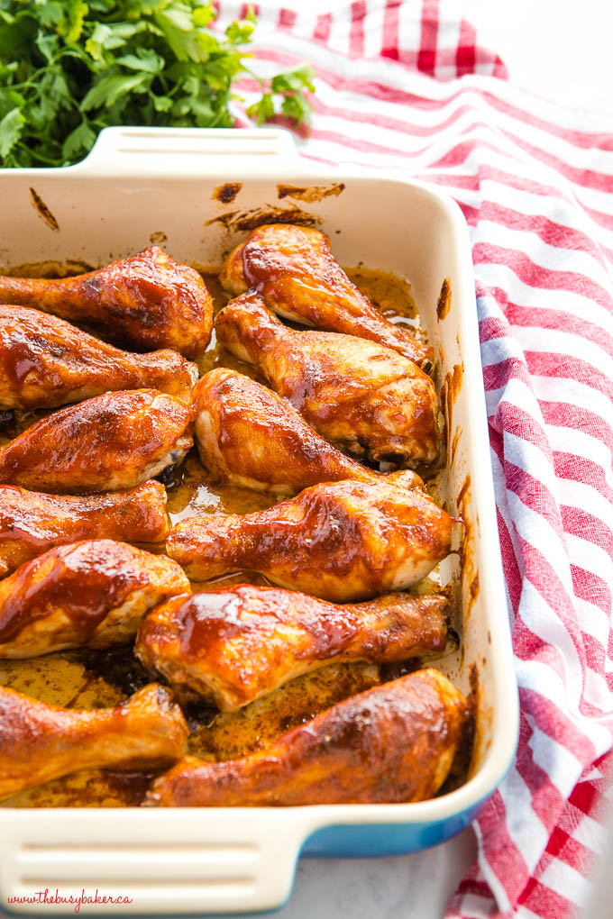 easy oven roasted barbecue chicken in blue casserole dish