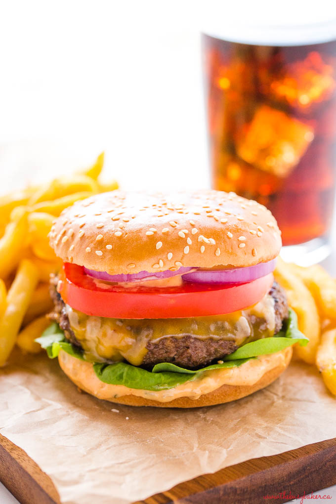 homemade cheeseburger with fries and coke with ice