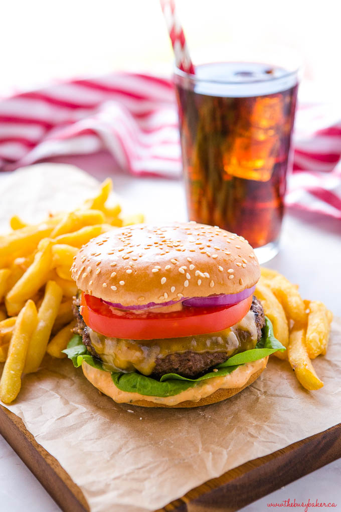 cheeseburger on platter with fries and coke