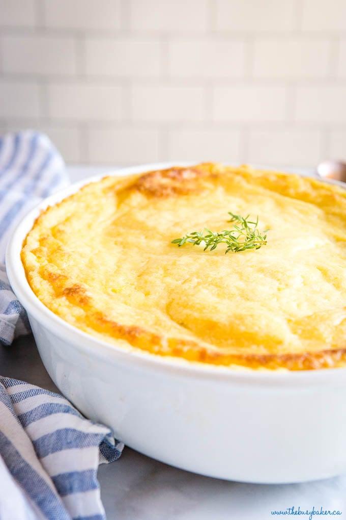 creamy mashed potatoes on white baking dish