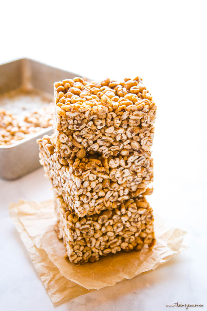 stack of 3 caramel puffed wheat squares on parchment paper