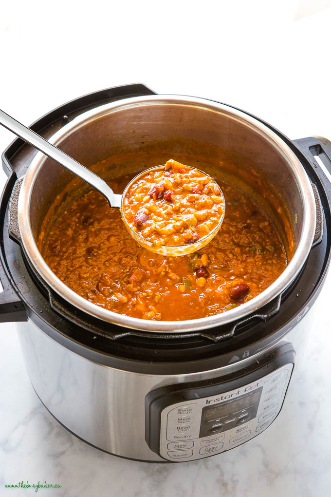 ladle of instant pot beef and bean chili in the Instant Pot