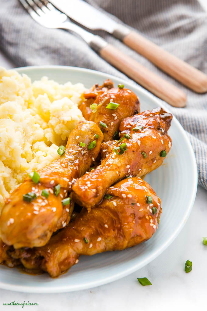 light blue plate with honey garlic chicken drumsticks with mashed potatoes