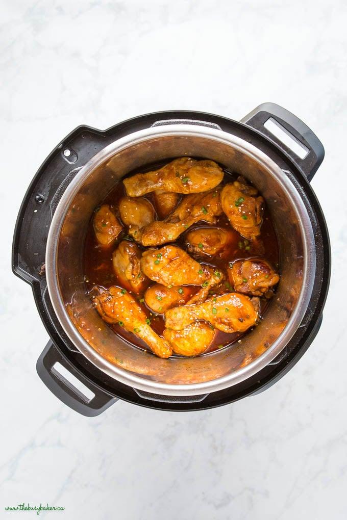overhead image: instant pot with honey garlic chicken drumsticks
