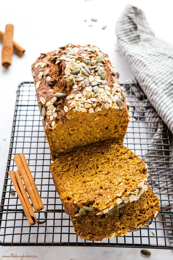 healthy pumpkin oat bread with oats, pumpkin seeds and cinnamon sticks
