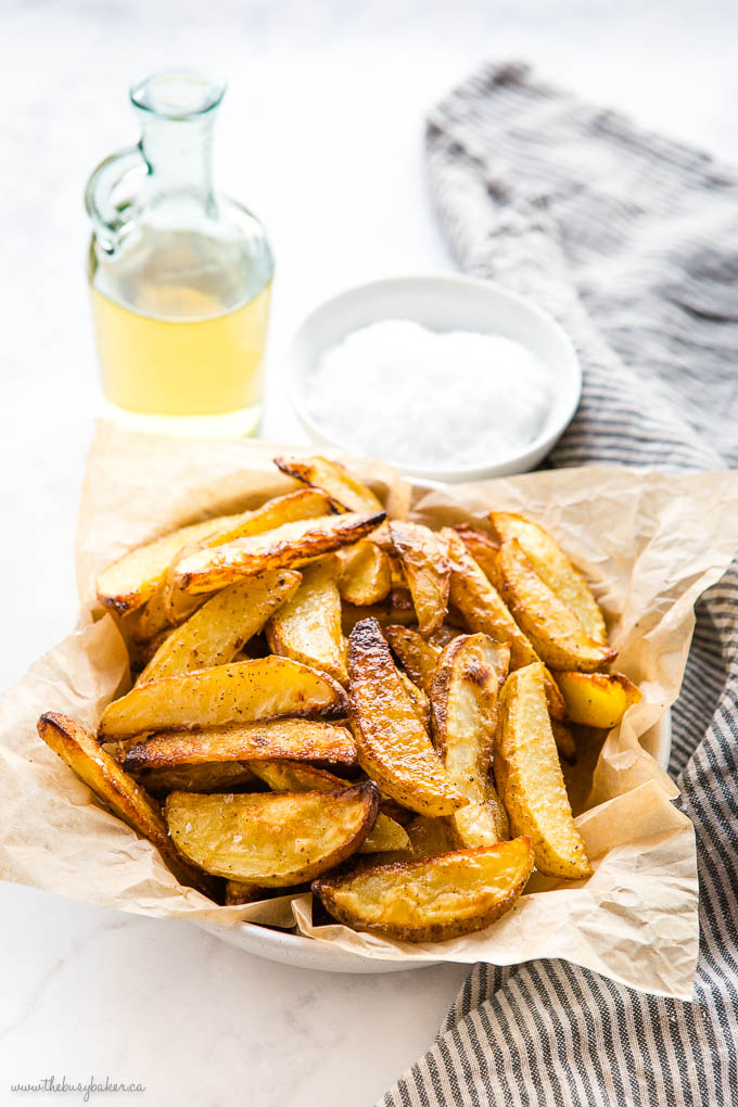 bowl of crispy potato wedges with salt and vinegar