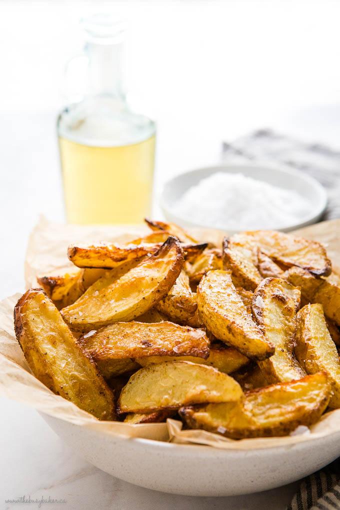 bowl of crispy potato wedges with flaky sea salt