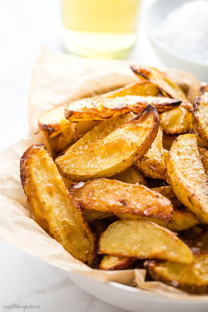 closeup image of crispy potato wedges with flaky sea salt and vinegar