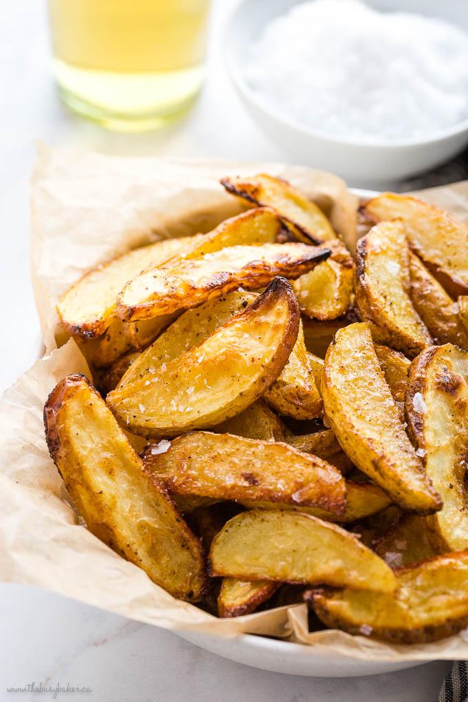 batch of crispy salt and vinegar potato wedges with flaky sea salt