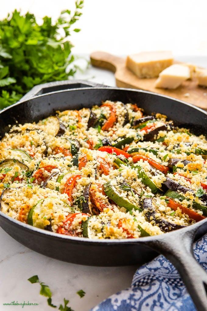 cast iron skillet with tomato, zucchini and eggplant gratin