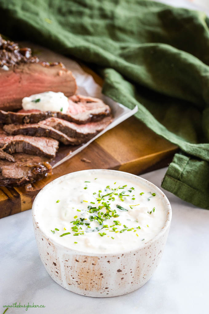 small bowl of horseradish sauce with chopped chives