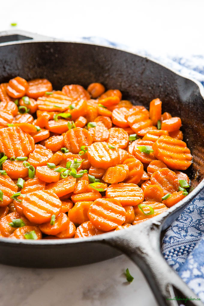 honey glazed carrots side dish in cast iron pan