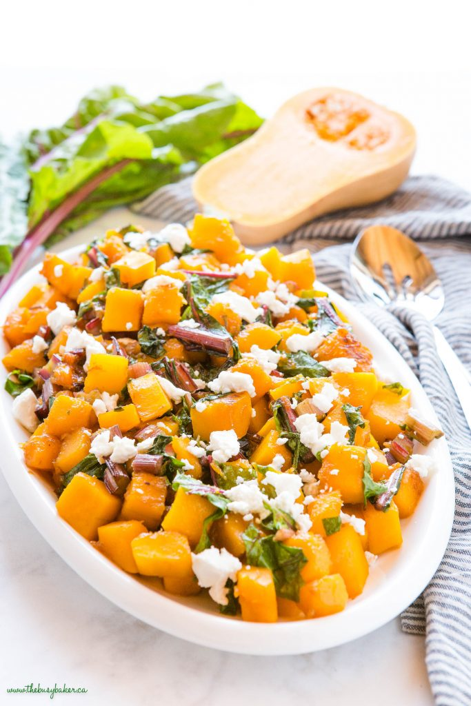 caramelized butternut squash with sautéed greens and goat cheese