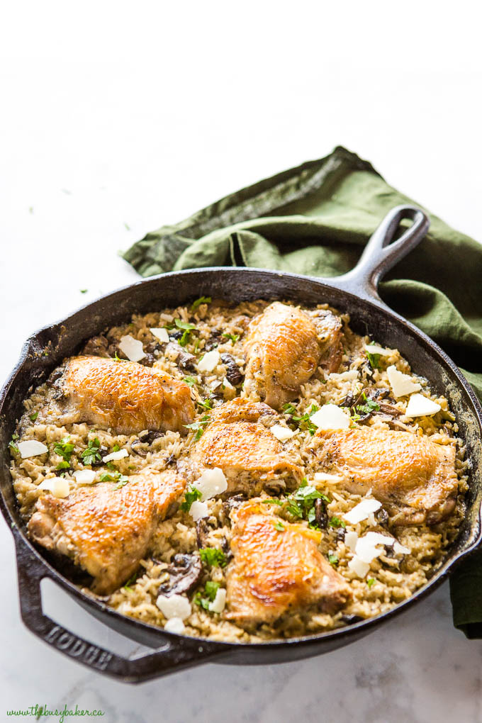 Lodge cast iron pan with crispy chicken and creamy rice bake, and fresh herbs