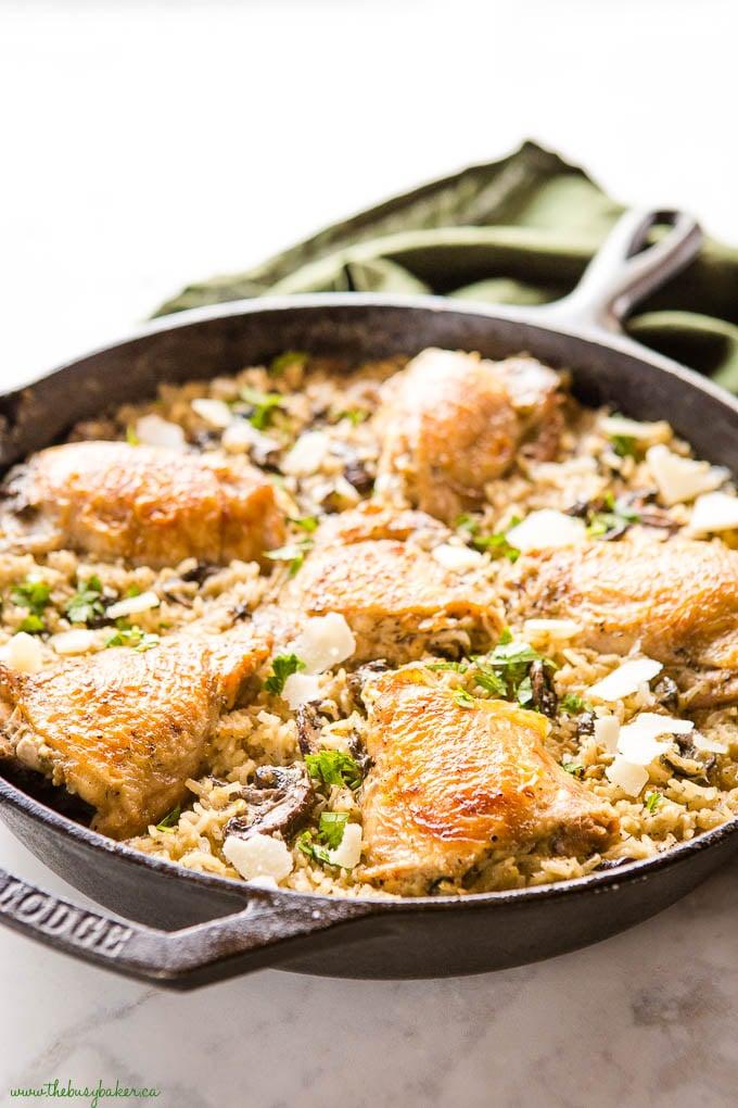 crispy chicken in cast iron pan with mushroom rice
