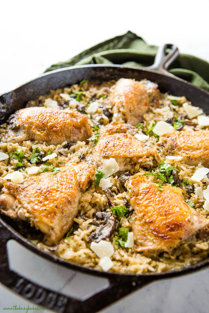 crispy skinned chicken thighs cooked in mushroom rice with parmesan cheese
