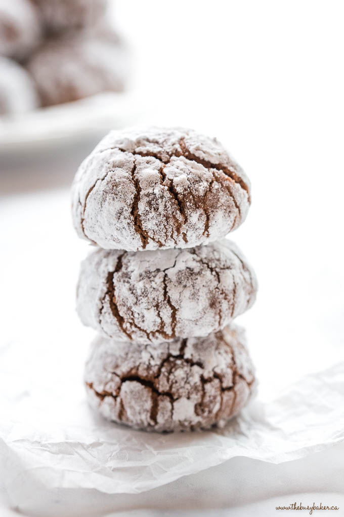 a stack of 3 chocolate crinkle cookies