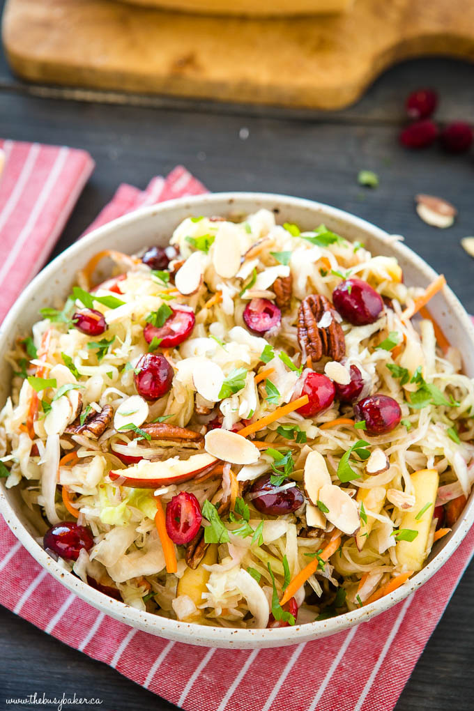 bowl of maple cranberry coleslaw with almonds and pecans