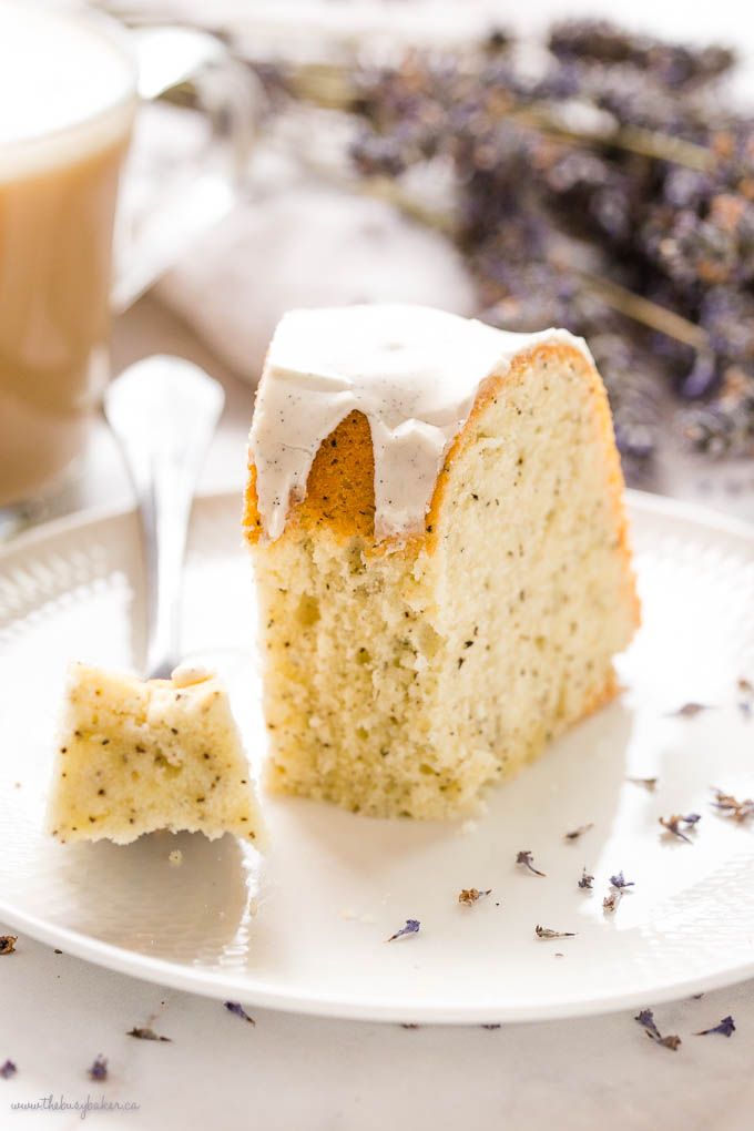 fork holding a bite of earl grey bundt cake with vanilla glaze