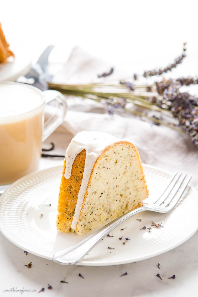 slice of earl grey vanilla bundt cake on white plate with fork
